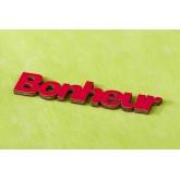 Mots « BONHEUR » sur sticker rouge