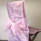 Housses de chaise + noeud en non tissé rose (x10)