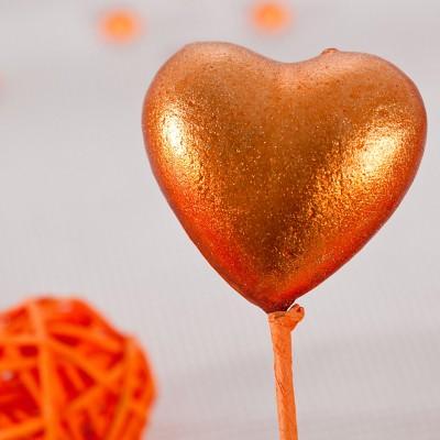 Piquets cœurs irisés orange (x2)