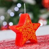 Bougie étoile rouge et ses flocons
