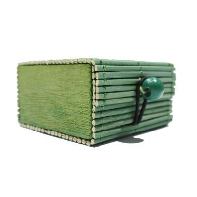 Coffre en rotin vert sapin